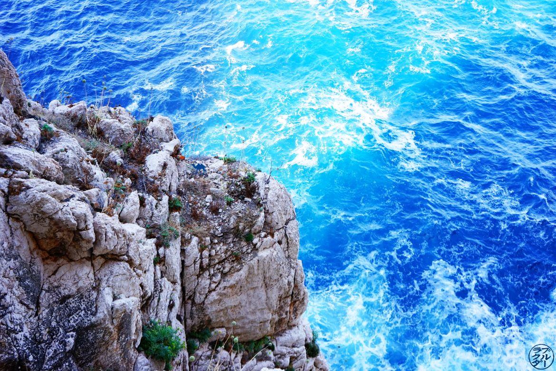 Le Chameau Bleu - Blog Voyage Sardaigne - falaises de la grotte de neptune Sardaigne Italie